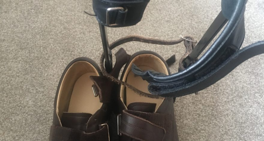 Dads empty shoes and leg brace