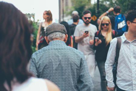 Elderly man in a crowd