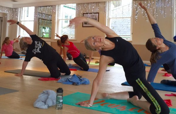 Women stretching in a pilates class