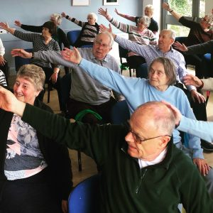 Active Seniors exercising in a community centre
