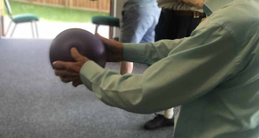 Standing exercise with ball